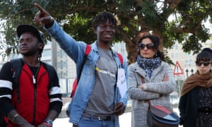 Abubakar Dukuly leads locals on a walking tour around Catania in eastern Sicily