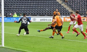 Mallik Wilks prods home the decisive goal in added time for Hull against Middlesbrough in their Championship match.
