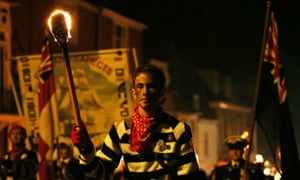 Thousands of people gather with flaming torches to march through the streets and burn effigies as part of the local tradition