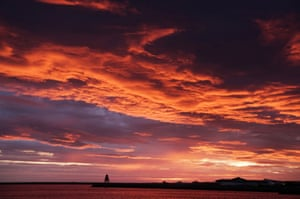 South Shields, England Sunrise over the Herd Groyne lighthouse