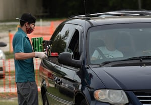 At the Ocala half of the parking spaces are roped off, providing 10-12 feet of social distance between each vehicle, and food orders are delivered to cars by servers wearing protective masks and gloves