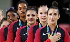 Gabby Douglas (fourth from right) during the medal ceremony