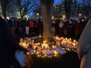 People taking part in a n unofficial vigil at College Green in Bristol.