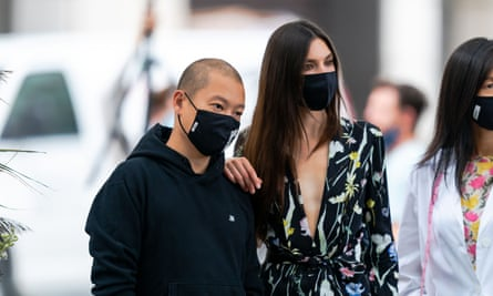 Designer Jason Wu (left) with American model Jacquelyn Jablonski as he prepares to open New York fashion week with a scaled-down rooftop catwalk for 30 people.