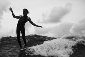 A surfer hangs 10