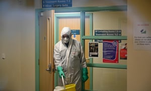 A worker in protective clothing inside the County Oak medical centre in Brighton.