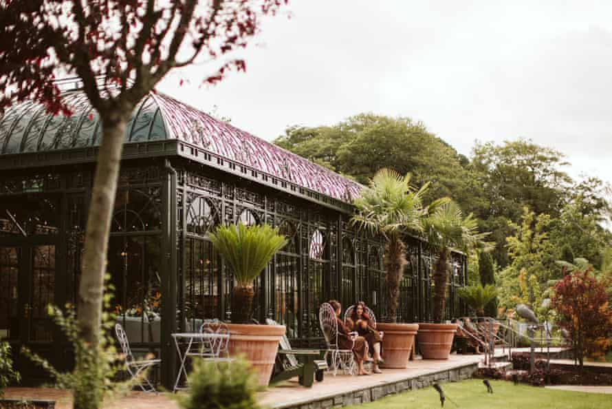 Two guests sat outside the Palm House, Galgorm Spa and Golf Resort, Ballymena, Northern Ireland, UK.