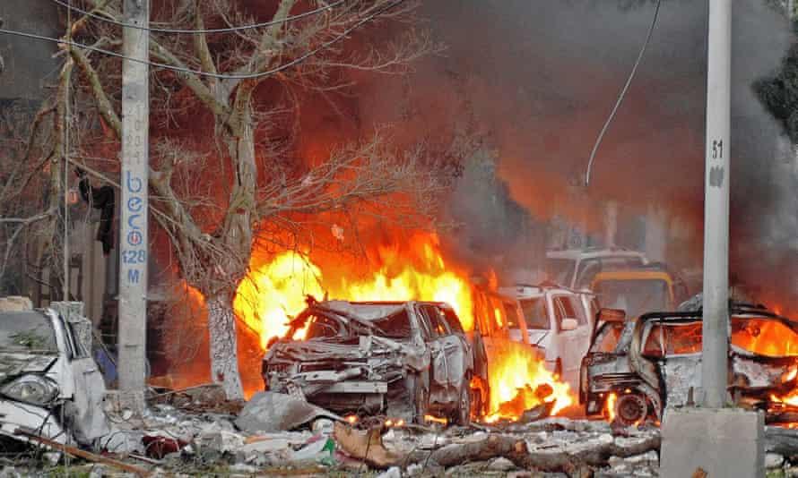 Wrecked cars burn