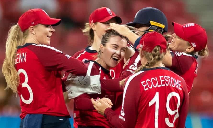 Mady Villiers (centre) is congratulated by her England teammates after running out Aaliyah Alleyne.