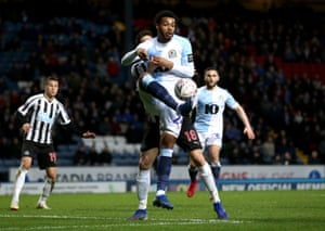 Joe Nuttall of Blackburn and Federico Fernandez of Newcastle United battle for the ball.