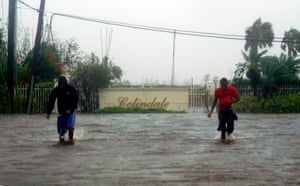 Residents wade through a street flooded with water brought on by Hurricane Dorian in Freeport, Bahamas, Tuesday, Sept. 3, 2019. Dorian is beginning to inch northwestward after being stationary over the Bahamas, where its relentless winds have caused catastrophic damage and flooding.