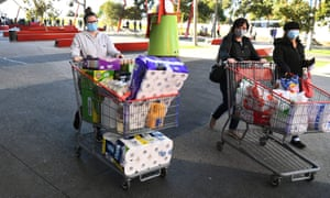 shoppers with trolleys of supermarket items