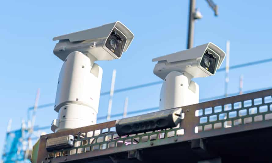 Facial recognition cameras are seen outside Romford station.