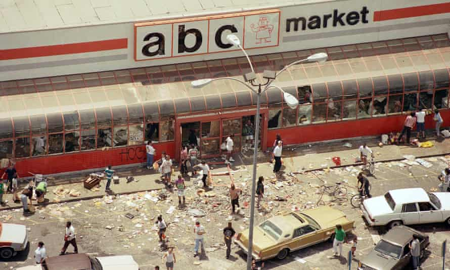 Looters in the parking lot of the ABC Market in south central Los Angeles on 30 April1992.