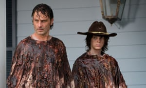 Bloodied but unbowed: Andrew Lincoln, left, and Chandler Riggs in The Walking Dead.