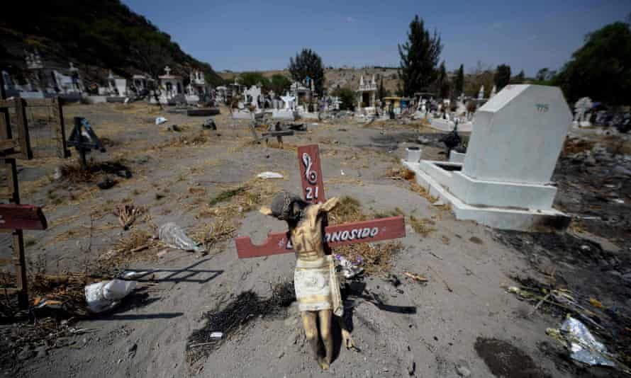 Graves in a section of a cemetery in Valle de Chalco set aside for coronavirus victims.