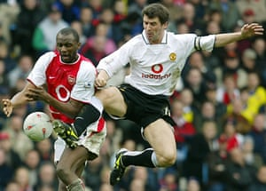 Manchester United's Roy Keane, right, and Arsenal's Patrick Vieira battle for the ball in 2004.
