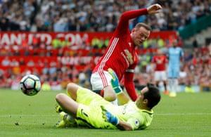 Claudio Bravo challenges Wayne Rooney.