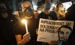 Protest against Jair Bolsonaro, in Sao Paulo, Brazil over the weekend. The president is facing a probe for pandemic mismanagement as the country counts over 500,000 Covid deaths.