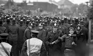 Police arrest a miner outside the Orgreave coking plant in 1984