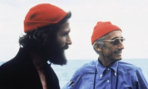 Jacques Cousteau (right) in his trademark red hat.
