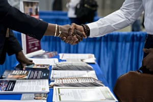 A job seeker shakes hands with a representative during a job fair hosted in Washington DC in August. In April 2019, when the overall unemployment rate was 3.6%, the white unemployment unemployment rate was 3.1% while the black unemployment rate was 6.7%.