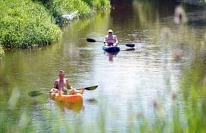 Wimborne, UKPeople kayak along the river Stour