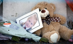 A picture of Alesha MacPhail is among the tributes left outside her family's home in Bute.