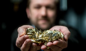 Man holding large pile of coins in both hands
