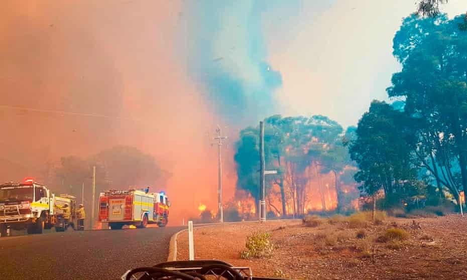 Firefighters attend a blaze at Wooroloo, near Perth, Australia