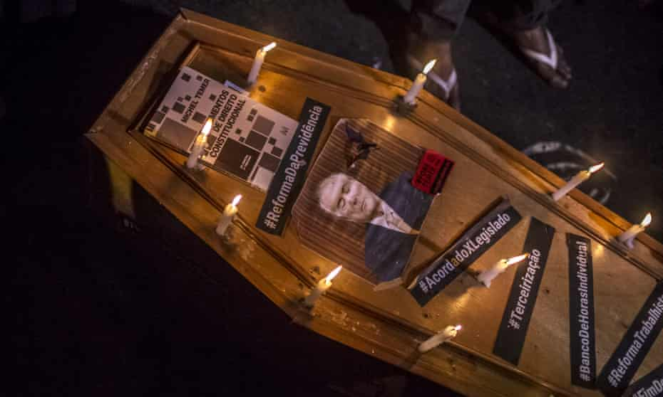 A photograph of Michel Temer, president of Brazil, on a mock coffin during a protest in Rio de Janeiro last month.