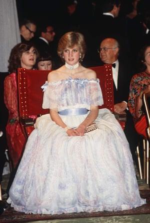 Diana wears a Bellville Sassoon dress and a chunky pearl choker.