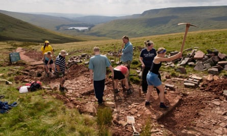 National Trust volunteers relaying a footpath from in the Brecon Beacons.