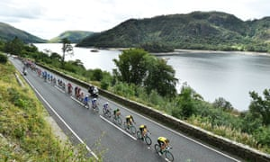 Primoz Roglic (fourth right) and Team LottoNL lead the way as the peloton passes the reservoir at Thirlmere.
