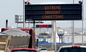 A highway sign and a retail sign detail the current drought and extreme temperatures currently plaguing the southwest U.S. in Fort Worth, Texas August 5, 2011.
