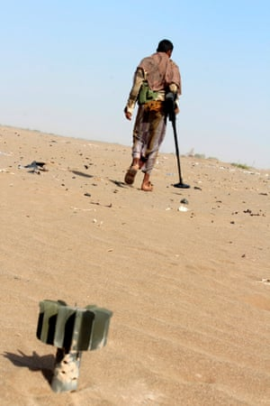 A member of the Yemeni pro-government forces searches for mines on the eastern outskirts of Hodeidah