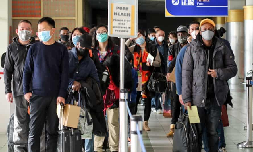 Passengers waiting to be screened at Jomo Kenyatta airport in Nairobi, Kenya, after arriving from China.