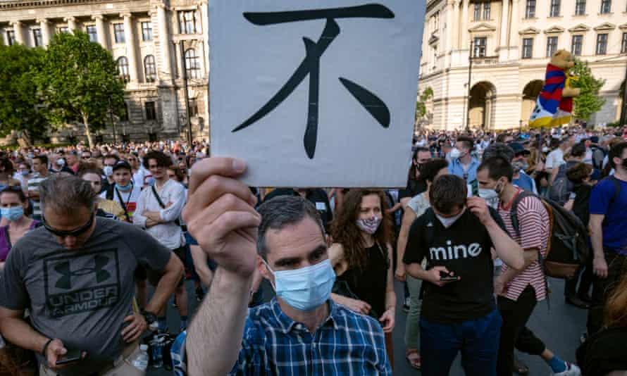 A protester in Budapest with a placard that reads 'No'
