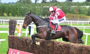 Total Recall, ridden by Ruby Walsh, jumps the last fence to win the Munster National
