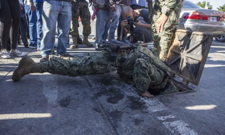 A Mexican soldier searches sewers near where Guzmán and an accomplice were captured.