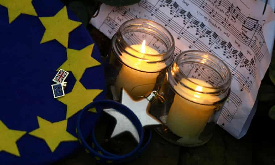 Candles burn next to sheet music for Auld Lang Syne in central London on Brexit day, 31 January.