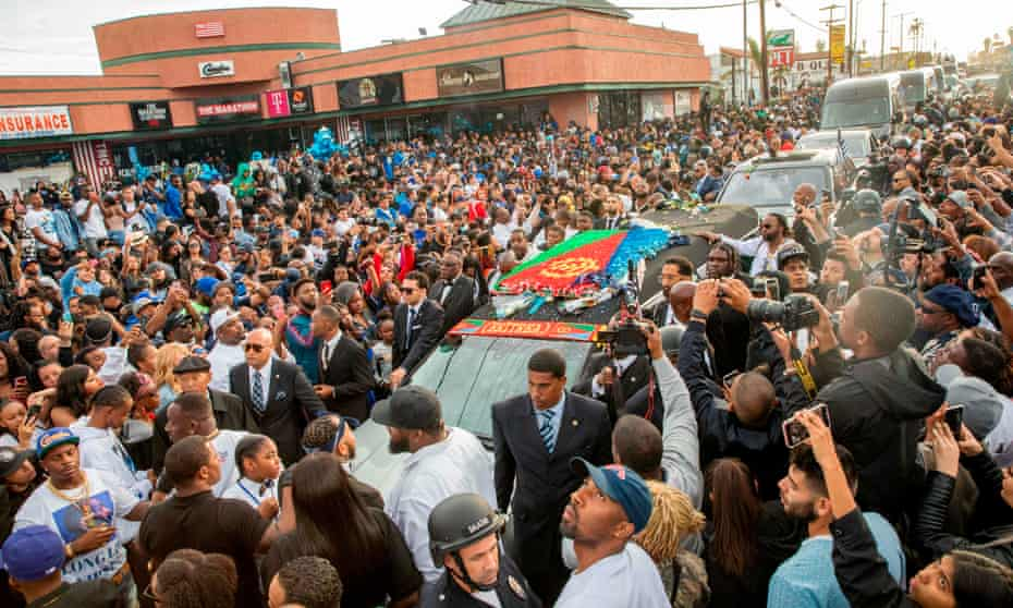 Nipsey Hussle's procession passes his Marathon Clothing store after his memorial.