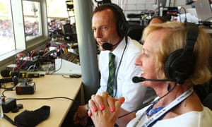 The Australian prime minister, Tony Abbott, sits in with the ABC Radio commentary team with Catherine McGregor to commentate during the international tour match between the Prime Minister's XI and England in Canberra in 2014.