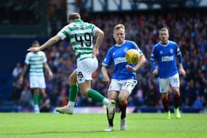 Scott Arfield of Rangers FC battles for possession with James Forrest of Celtic.