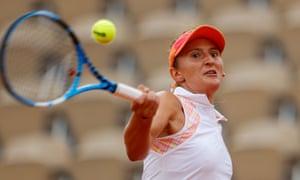 Irina Begu returns the ball to Simona Halep.