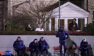 José Mourinho watches with his backroom staff and the residents of Rossett Road