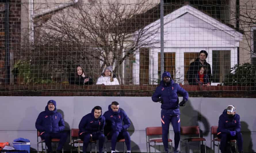 José Mourinho watches with his backroom staff and Rossett Road residents