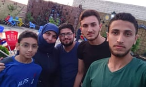Noor al-Dein al-Dimashqi, with her sons, from left, Hamza, 12, Suleyman, 26, Bilal, 19, and Omran, 22, last summer.