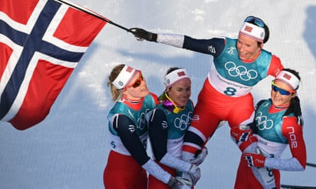 Marit Bjørgen is carried by her teammates after winning the women's 30km cross-country mass start classic, bringing Norway's Pyeongchang medal tally to 39.