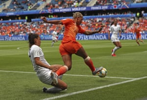 Netherlands' Shanice Van De Sanden gets away from New Zealand's Ali Riley to send in a cross.